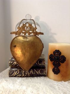 Religious Ex Votos Milagros Flaming Sacred Heart Hanging  Mirror Lockett  Brass Gold Color Single item by lamoneeboutique on Etsy https://www.etsy.com/listing/240866335/religious-ex-votos-milagros-flaming