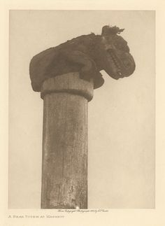 Title:A Bear Totem at Massett Description:View of a weathered totem pole with a bear figure on top. Culture/People:Haida [Masset] Date created:Copyright 1915