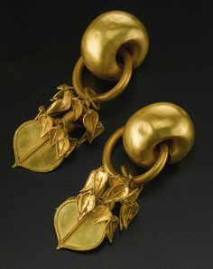 KOREAN GOLD JEWELRY THREE KINGDOMS, SILLA KINGDOM PERIOD, 5TH-6TH CENTURY earrings consisting of a thick hollow tube suspending a cluster of small leaves with a round leaf-shaped thin plate