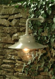 Each Belfast Light in Clay  is carefully crafted from our durable powder coated metal/   perfect for illuminating the once hidden shores of your country garden/ .