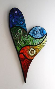 Mosaic heart wall hanging made with stained glass and glass beads on a wood surface. Mosaic Crafts, Mosaic Projects, Mosaic Art, Mosaic Glass, Mosaic Tiles, Stained Glass, Mosaics, Mosaic Designs, Mosaic Patterns