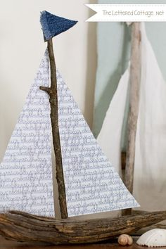 Make a sailboat out of sticks from your backyard. Use a hot glue gun to attach scrapbook paper for the sails and and two small denim triangles for a flag.