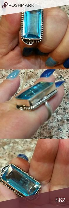 Genuine Blue Topaz Ring Size 7 Full slender finger cut. Set on 925 stamped Solid Sterling Silver. Please see all pictures for details. Brand New. Never Worn. Wholesale cost. MSRP 410.00 Jewelry Rings