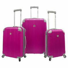 Jetset in style with this textured luggage set, perfect for weekend jaunts and exotic getaways. 3 rolling suitcases feature 360-degree wheels and self-lock telescoping handles.   Product: Small, medium and large suitcaseConstruction Material: ABS composite and aluminumColor: MagentaFeatures:  Four-corner riveted protective shells for durabilitySelf-locking telescopic handle system with push-down mechanismFully lined interior with organizational pockets, tie-down straps and shoes ...