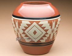 This is an authentic Native American pottery vase. This hand made Sioux Indian vase has a smooth glazed surface with beautiful hand etched Indian art. An American Indian pottery vase is a prized poses