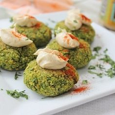 Spinach falafel gluten free with a dollop of tahini and a dash of paprika! So simple, so incredibly delicious!