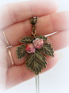Bronze leaf with red berries covered with snow necklace. Stylish bronze  necklace. Delicate Jewelry. by JuliaCreaStyle on Etsy https://www.etsy.com/listing/227441045/bronze-leaf-with-red-berries-covered