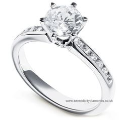 A beautiful new Tiffany style diamond solitaire engagement ring with simple six claw setting and channel set diamond shoulders. One amongst a select offering of perfect engagement rings.