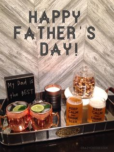 Father's Day Gift Idea! Put together a stylish and sleek cocktail tray for Dad! Add a couple of Moscow Mule mugs, a masculine candle, 'Keep Calm and Drink Beer' glasses, trail mix in a No.1 jar, and the perfect little sign to remind Dad he's the Best! All available at HomeGoods. Sponsored Pin