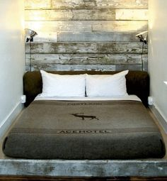 Portland's Ace Hotel, offers tons of beautiful ideas, including this reclaimed wood headboard and sconces. Idea for half wall Ace Hotel Portland, Portland Oregon, Downtown Portland, Seattle, Reclaimed Wood Headboard, Salvaged Wood, Repurposed Wood, Recycled Wood, Weathered Wood
