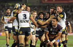 Justin O'Neill of the Cowboys celebrates scoring a try with team mates