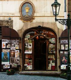 Storefront on Nerudova Street The Little Quarter, Prague, Czech Republic - centuries old doorway signs, which once served as street addresses, still remain on the buildings in this area. By Larry Myhre via flickr
