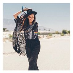 Gizele Oliveira wears a sheer maxi skirt and Pink Floyd Tshirt in the LA desert | Shop the Story at Fashiolista.com