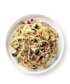 The no-cook sauce is bursting with briny, complex flavors—marinated artichokes, chopped sardines, grated pecorino, and roasted almonds. Get the recipe for Artichoke and Sardine Spaghetti.