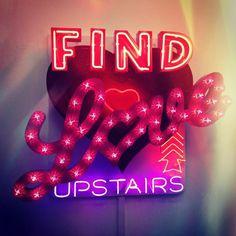 'Find Love Upstairs' Neon by artist Chris Bracey