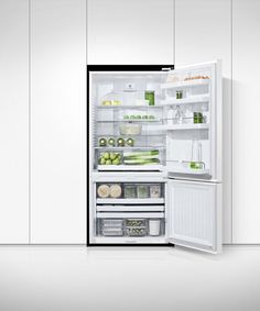 This white refrigerator with bottom freezer has large, flexible storage options for a busy household. Shelf Bins, Door Shelves, Storage Bins, Glass Shelves, Shelving, Locker Storage, White Refrigerator, Stainless Steel Refrigerator