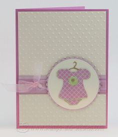 I made the outfit on the cricut with the new arrival cartridge and the circles are cut with nestabilities. Paper is: Imaginisce, Stampin Up, and Bazzill. I think the ribbon is Stampin' Up organdy. Swiss Dots cuttlebug folder.