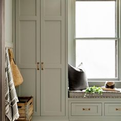 Today we are sharing a trending color for sage green. This soft green-grey is a fresh neutral that looks beautiful on cabinetry. Check out these laundry rooms and kitchens + check out our green paint guide. Mudroom Cabinets, Cleaning Cabinets, Kitchen Cupboards, Farrow And Ball Kitchen, Farrow And Ball Paint, White Brick Tiles, Design Trends 2018, Solid Doors, Green Kitchen