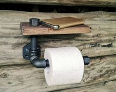 Complete your rustic bathroom design with this custom industrial toilet paper holder with shelf made from unfinished iron fittings and wood pipes. Due to the manufacturing process, there may be variations in the conduct and texture of the - Industrial Toilets, Industrial Shelving, Industrial Bathroom, Wood Bathroom, Bathroom Shelves, Bathroom Colors, Rustic Industrial, Small Bathroom, Minimalist Toilets
