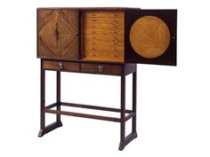 A Japanese style wood cabinet by English furniture designer and architect Ernest William Gimson