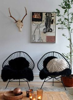 a danish family home by the style files, via Flickr black hoop chair, black sheepskin throw, abstract art