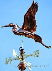 Polished copper Blue Heron weathervane.
