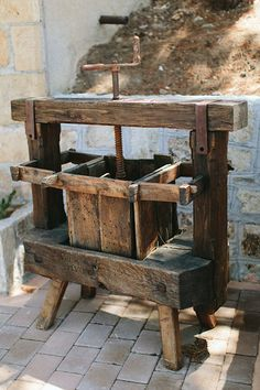 "Antique wine press at the ""Wooden Oven Courtyard"" 