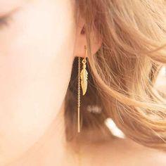 LIGHT AS A FEATHER earrings by Katie Dean Jewelry.
