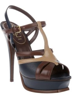 You will be mine! (When I win the lottery)- Brown leather sandals from Yves Saint Laurent featuring navy and beige front straps, a t-bar, a brown and navy ankle strap with a gold-tone buckle fastening, a navy platform with brown piping and a navy stiletto heel.