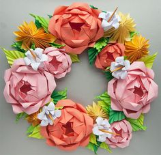 This rose and dahlia wreath is made entirely out of paper. Wow!