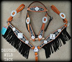 Extreme Bling Tack Set~This is so pretty. Good thing i have a mare because my gelding would be soo embarassed!