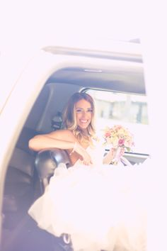 We #love this #casual #photo of the #gorgeous #bride looking #radiant + #happy in the #limo on her #weddingday! ::Ashley + Robert's delightful outdoor wedding at the Los Verdes Golf Club in Ranco Palos Verdes, California:: #stunningbride #beautifulbride #weddingphotography #californiaweddingphotographer #bright #light #pretty #photography #transportation #bridalfashion