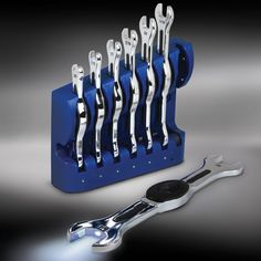 The Only Rechargeable Illuminating Wrenches - Hammacher Schlemmer - This is the wrench set with built-in LEDs that provide directional light without wires, hot bulbs, or an assistant to hold a flashlight.