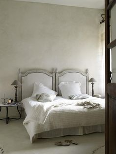 The Louis XVI painted wooden headboards, purchased at a local shop, were covered (by Nicole and her mother) in linen from John England Textiles Ltd. The marble-topped iron side table was bought at a market in Lagrasse and the bedspread came from Pier Import at Carrefour Narbonne, France.