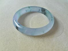 Translucent Hand Carved Blue Jadeite Bangle