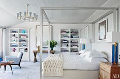 A 1960 Paavo Tynell chandelier from Alexandre Biaggi crowns the master bedroom of this Sagaponack, New York, beach house with interiors by Cullman & Kravis.