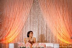This Indian bride and groom celebrate their wedding with lots of style. Their New Jersey event stuns with beautiful floral and decor.