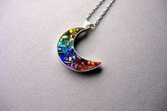 Made especially for me, these are my EXCLUSIVE, very cool, Crescent Moon Pendants! Nobody else will have this exact handmade pendant. Who doesnt love a rainbow?! This is my take on one. There is something magical about the way the textures and hues of colors work together. A rainbow of red, yellow, orange, green, turquoise, blue and purple glass. Every sliver is hand cut by me to fit in the exact spot it is in. The glitter glass, swavorski crystal, glass seed beads, iridescent tiles come in…