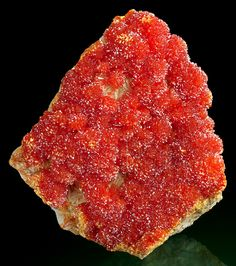 Fiery-orange clusters of Orpiment on Barite