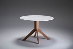 The Finnegan round dining table is an Australian made with a timber pedestal base with carrara marble top. designed 2014. #australiandesign #australiandesign #AustralianFurniture #graziaandco #roundtable