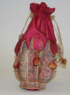 Bag Date: 1860–70 Culture: Italian Medium: silk Dimensions: Length: 11 x 6 in. (27.9 x 15.2 cm) Accession Number: 26.56.82 The Metropolitan Museum of Art