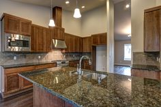 Ramblewood plan: 2946 sq ft - Rambler model home has Verde Butterfly granite counters, stainless steel appliances and Pecan stained cabinets