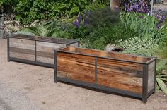 Steel frame planters with reclaimed cedar wood insert by Custom by Rushton at http://custombyrushton.com/planters/rustic-steel-frame-with-reclaimed-wood/