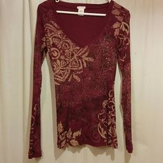 Long sleeve burgundy shirt Burgundy and beige with a few sparkles on left side Maurices Tops Tees - Long Sleeve