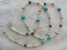 Eyeglass Chain decorated with Turquoise Howlite,  Hematite and Pearls. Visit arepaki.etsy.com