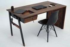 On the left side of the desk is a built-in leather mouse pad.