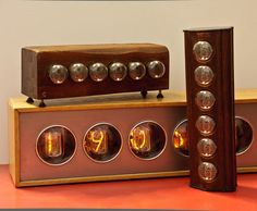 Gorgeous Nixie Tube Clock Instructable - there are magnifying lenses in front of each tube, so it's 3Xs the size!