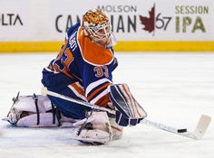 Edmonton Oilers' goalie Cam Talbot (33) makes a save against the Anaheim Ducks during the first period of an NHL hockey game, Tuesday, Feb. 16, 2016 in Edmonton, Alberta. (Codie McLachlan/The Canadian Press via AP)