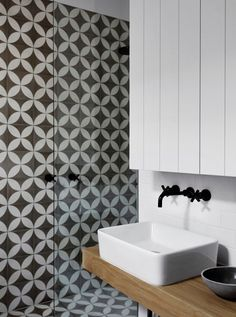 Geometric tile for a backsplash or wall | Whiting Bathroom with Black Tapware | Remodelista