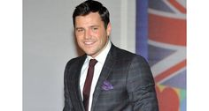 Mark Wright dresses up Essex style for the Brit Awards in a checked grey suit and contrasting maroon tie!